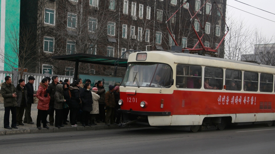 In this Saturday, Feb. 2, 2019 photo, people queue up to board a tram in Pyongyang, North Korea. (AP Photo/Dita Alangkara)
