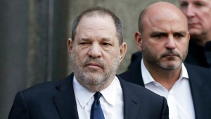 In this Thursday, Dec. 20, 2018, file photo, Harvey Weinstein, left, leaves New York Supreme Court in New York. (AP Photo/Mark Lennihan)
