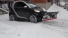 Frank Espina attached a plow to a Smart car