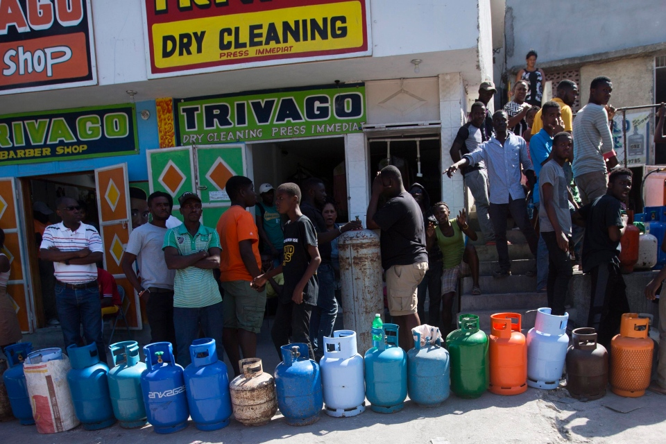 Residents line up to buy propane gas in Port-au-Prince, Haiti, Monday, Feb. 18, 2019. (AP Photo/Dieu Nalio Chery)