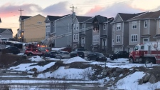 Police and emergency crews respond to a fatal house fire in Spryfield on Feb. 19, 2019.