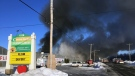 Thick black smoke billowed from a fire at a greenhouse more than four hours after it began (CTV Montreal/J.L. Boulch)