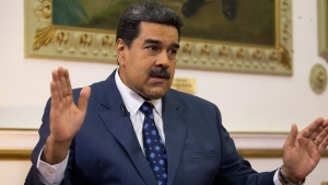 Venezuela's President Nicolas Maduro speaks during an interview with The Associated Press at Miraflores presidential palace in Caracas, Venezuela, Thursday, Feb. 14, 2019.  (AP Photo/Ariana Cubillos)