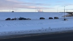 A crash involving a number of vehicles on Stoney Trail in the city's southeast slowed traffic while crews removed a downed light standard.