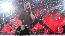 In this Feb. 1, 2018, file photo, Imagine Dragons perform at the EA Sports Bowl at The Armory in Minneapolis. Imagine Dragons will perform at the Pro Football Hall of Fame on Aug. 4, 2019, to help kick off the NFL's 100th season. (Photo by Omar Vega/Invision/AP)