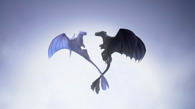 "This image released by Universal Pictures shows characters, female Light Fury dragon, left, and Night Fury dragon Toothless, in a scene from DreamWorks Animation's ""How to Train Your Dragon: The Hidden World."" (DreamWorks Animation/Universal Pictures via AP)"
