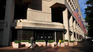 FILE - In this May 9, 2017, file photo, the J. Edgar Hoover FBI building on Pennsylvania Avenue in Washington. (AP Photo/Jacquelyn Martin, File)
