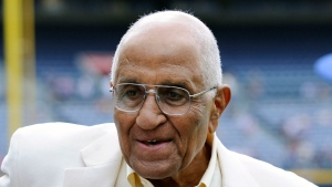 In this Aug. 18, 2012, file photo, former Dodgers pitcher Don Newcombe stands on the field at Turner Field, where he received the Beacon of Hope Award before the Civil Rights Game, in Atlanta. The team confirmed that Newcombe died Tuesday morning, Feb. 19, 2019, after a lengthy illness.(AP Photo/John Amis)
