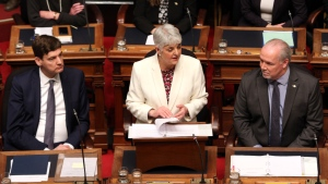 Attorney General David Eby, left and Premier John Horgan look on as Finance Minister Carole James delivers the budget speech at the legislature in Victoria, B.C., on Tuesday, February 19, 2018. THE CANADIAN PRESS/Chad Hipolito