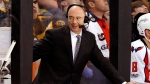 In this April 8, 2017, file photo, Pierre McGuire broadcasts from between the benches during the third period of an NHL hockey game between the Boston Bruins and the Washington Capitals in Boston.  (AP Photo/Winslow Townson, FIie)