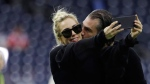Lady Gaga takes a selfie with Christian Carino before the NFL Super Bowl 51 football game between the New England Patriots and the Atlanta Falcons, Sunday, Feb. 5, 2017, in Houston. (AP Photo/Jae C. Hong)