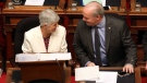 Finance Minister Carole James talks with Premier John Horgan before delivering the budget speech at the legislature in Victoria, B.C., on Tuesday, February 19, 2018. (Chad Hipolito / THE CANADIAN PRESS)