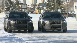 Calgary Police Service units at the Inland Concrete Spy Hill plant on February 19, 2019 after a worker was fatally injured by a concrete block
