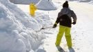 8-year-old tackles snow