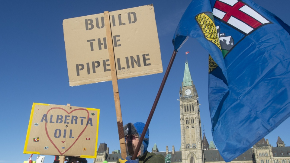 Pro-pipeline protesters stand on Parliament Hill in Ottawa, Tuesday Feb. 19, 2019. THE CANADIAN PRESS/Adrian Wyld