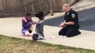 Officer plays with kids during false alarm