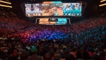 FILE - In this July 28, 2018, file photo, fans watch the competition between Philadelphia Fusion and London Spitfire during the Overwatch League Grand Finals competition at Barclays Center in the Brooklyn borough of New York. With eight new franchises and plans to take its regular season on the road for the first time, the Overwatch League is opening its second year a few steps closer to its goal of becoming a truly global, city-based esports league. (AP Photo/Mary Altaffer, File)
