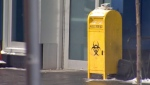 A used needle drop box outside of the supervised consumption site at the Sheldon M. Chumir Health Centre