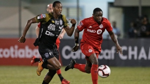 Abdiel Ayarza of Panama's Club Atletico Independiente FC , left, and Chris Mavinga of Canada's Toronto FC compete for the ball during a CONCACAF Champions League soccer match in La Chorrera, Panama, Tuesday, Feb., 19, 2019 (AP Photo/Arnulfo Franco)