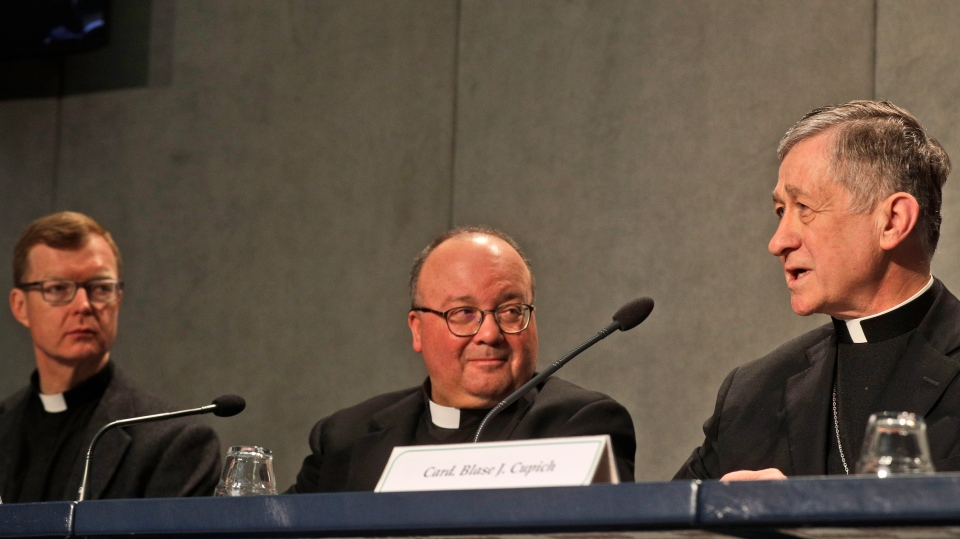 Cardinal Blase J. Cupich, Chicago Archbishop, right, speaks as Mons. Charles Scicluna, Malta Archbishop, and Rev. Hans Zollner, left, listen during a press conference on a Vatican summit on preventing clergy sex abuse, at the Vatican, Monday, Feb. 18, 2019. (AP Photo/Gregorio Borgia)