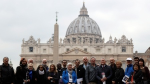 Members of the ECA (Ending of Clergy Abuse) organization and survivors of clergy sex abuse pose for photographers outside St. Peter's Square, at he Vatican, Monday, Feb. 18, 2019. (AP Photo/Gregorio Borgia)