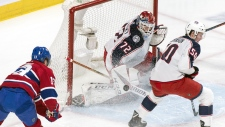 Montreal Canadiens centre Max Domi (13) scores past Columbus Blue Jackets goaltender Sergei Bobrovsky as Eric Robinson looks on during first period NHL hockey action in Montreal on Tuesday, February 19, 2019. THE CANADIAN PRESS/Paul Chiasson