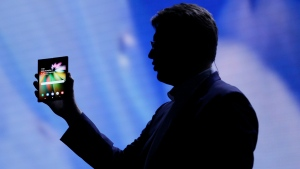 Justin Denison, senior vice-president of mobile product development, shows off the Infinity Flex Display of a folding smartphone during the keynote address of the Samsung Developer Conference, in San Francisco in this Nov. 7, 2018 file photo. (File/AP photo)