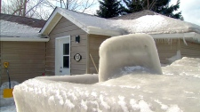 A home in Stoney Creek is encased in ice after a flurry of turbulent winter weather.