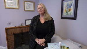 Colleen McQuarrie, naturopathic doctor and chair of the board of governors of the Canadian College of Naturopathic Medicine, poses in her office in Ottawa, Tuesday, February 5, 2019. Naturopathic clinics in Ontario offering Pap smears say their pampered approach to the medical procedure helps put patients at ease. (THE CANADIAN PRESS/Adrian Wyld)