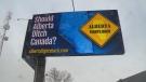 Billboard at corner of 99 Street and 63 Avenue.