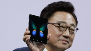 DJ Koh, President and CEO of IT and Mobile Communications, holds up the new Samsung Galaxy Fold smartphone during an event Wednesday, Feb. 20, 2019, in San Francisco. (AP Photo/Eric Risberg)