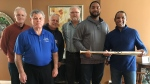 Richard Anderson, right, son of Stan 'Gabby' Anderson, accepts the golden bat for his father from London Majors' Cleveland Brownlee and other Majors alumni in London, Ont. on Wednesday, Feb. 20, 2019. (Brent Lale / CTV London)