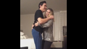 Canadian race car driver Robert Wickens stands for his fiancee Karli Woods in a video posted to Twitter. (Robert Wickens)