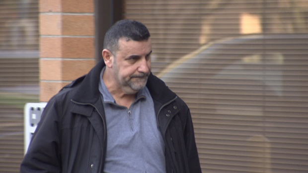 Amjed Jamo is seen leaving a Richmond, B.C. court on Wednesday, Feb. 20, 2019.