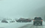 Numerous vehicles in the ditch of the Trans-Canada Highway east of Canmore on Wednesday afternoon (image courtesy: Rob Roughley)