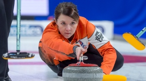 Skip Casey Scheidegger, from the Lethbridge Curling Club, releases a rock during the wild-card game against Kerri Einarson's rink from Gimli, Manitoba at the Scotties Tournament of Hearts at Centre 200 in Sydney, N.S. on Friday, Feb. 15, 2019. THE CANADIAN PRESS/Andrew Vaughan