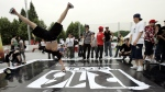 South Korean B-boy Lee Jong-sun, 23, left, dances during a three-day international dance battle in Seoul, South Korea, Friday, June 1, 2007. (AP Photo/ Lee Jin-man)