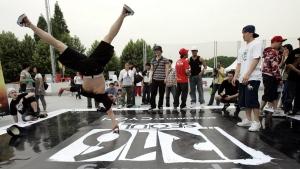 South Korean B-boy Lee Jong-sun, 23, left, dances during a three-day international dance battle in Seoul, South Korea, Friday, June 1, 2007. (AP Photo/ Lee Jin-man)