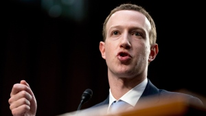 Facebook CEO Mark Zuckerberg testifies before a joint hearing of the Commerce and Judiciary Committees on Capitol Hill in Washington, Tuesday, April 10, 2018. THE CANADIAN PRESS/AP, Andrew Harnik