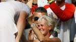 In this file photo dated Sunday, July 7, 2013, Andy Murray of Britain, left, greets his mother Judy after defeating Novak Djokovic of Serbia during the Men's singles final match at the All England Lawn Tennis Championships in Wimbledon, London. (AP Photo/Kirsty Wigglesworth)