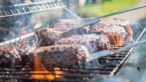 This file photo shows steaks being cooked on a barbecue.