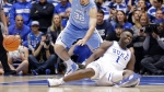 Duke's Zion Williamson (1) falls to the floor with an injury while chasing the ball with North Carolina's Luke Maye (32) during the first half of an NCAA college basketball game in Durham, N.C., Wednesday, Feb. 20, 2019. (AP Photo/Gerry Broome)
