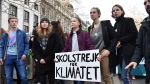 Swedish climate activist Greta Thunberg, center, holds a sign which reads 'school strike for the climate' during a climate march in Brussels, Thursday, Feb. 21, 2019. (AP Photo/Geert Vanden Wijngaert)