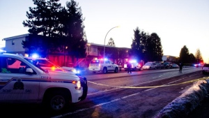 Police cruisers swarmed the building Thursday morning and officers taped off large swaths of road as they began their investigation. (Photo: mycomoxvalleynow.com)