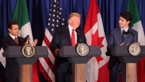 Flanked by Mexico's President Enrique Pena Nieto, left, and Canada's Prime Minister Justin Trudeau, U.S. President Donald Trump smiles during a signing ceremony of their trilateral trade agreement, on the sidelines of the Group of 20 summit in Buenos Aires, Argentina, on Friday, Nov. 30, 2018. (AP Photo/Martin Mejia)