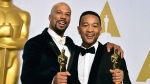 "In this Feb. 22, 2015 file photo, Common, left, and John Legend pose in the press room with the award for best original song for ""Glory"" from the film, ""Selma"" at the Oscars in Los Angeles. (Photo by Jordan Strauss/Invision/AP)"