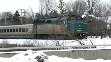 A woman died after being struck by a Via Rail train on Thursday.