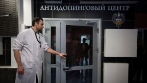 In this Tuesday, May 24, 2016 file photo, Grigory Dudko opens a door for journalists during a visit to Russia's national drug-testing laboratory in Moscow, Russia. (AP Photo/Alexander Zemlianichenko, File)