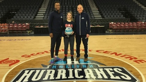 Our Hurricanes Hero, Hayley Elliott, stands with player Joel Kindred and coach Mike Leslie of the Halifax Hurricanes.