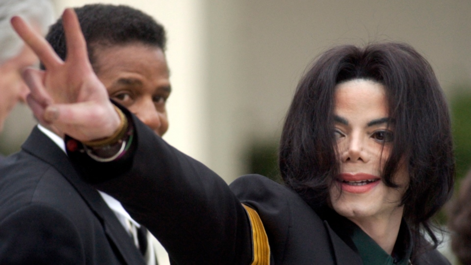 In this March 2, 2005 file photo, pop icon Michael Jackson waves to his supporters as he arrives for his child molestation trial at the Santa Barbara County Superior Court in Santa Maria, Calif. (AP Photo/Michael A. Mariant)